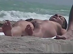 Stunning tanned brunette forth a neat pussy in a beach porno