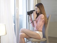 Svelte young chick Akira May gets horny while spying on high neighbors
