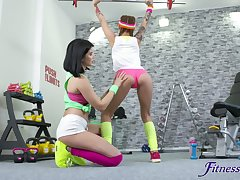 Lesbo sex in the home gym with natural tits model Dominika Dark