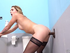 Alluring MILF strips nude for her first glory hole tryout
