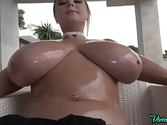 Oiled up curvy blonde babe Vivian Blush posing topless widely